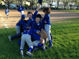 Cubs players dog pile